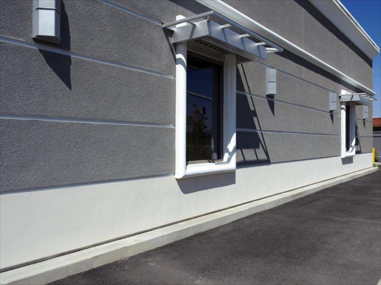 We Power Wash the Exterior of Drive-Thru Surfaces, Buildings, Sidewalks, and Parking Lots.