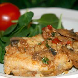 A great recipe for monkfish or tilapia with garlic, tomatoes, mushrooms, and white wine